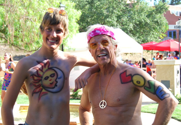 Man and son wearing airbrush body art