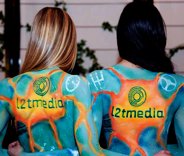 two models with corporate logos painted on their backs